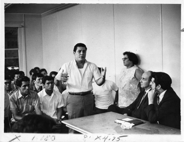 Puerto Rican Peter Castillo speaks at a meeting on August 15, 1969 with Hartford city officials. Others are Councilman Nicholas Carbone, at far right; city Manager Elisha C. Freedman; and Mrs. Maria Sanchez. CREDIT JUAN FUENTES/HARTFORD TIMES / HARTFORD HISTORY CENTER, HARTFORD PUBLIC LIBRARY
