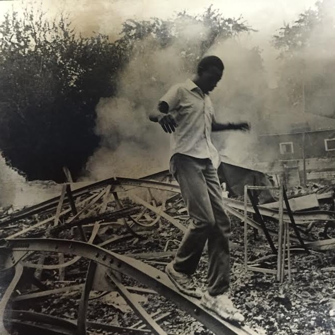 A Hartford citizen amongst the destruction caused by the rioting in September 1969